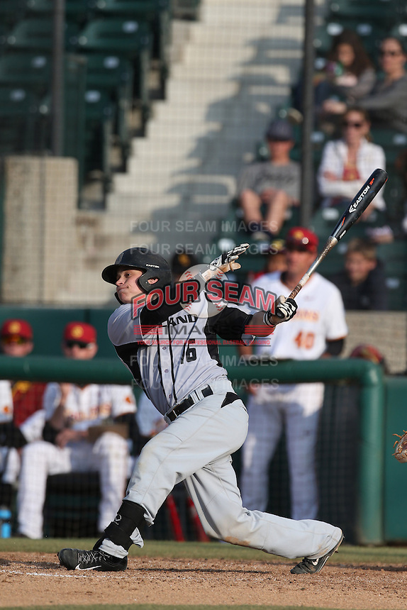 Ian Yetsko (16) of the Oakland Grizzlies bats during a game against the Southern California Trojans at Dedeaux Field on February 21, 2015 in Los Angeles, California. Southern California defeated Oakland, 11-1. (Larry Goren/Four Seam Images)