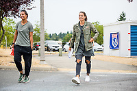 TACOMA, WA - JULY 31: Sarah Bouhaddi #12 and Dzsenifer Marozsan #8 of the OL Reign arrive at the stadium before a game between Racing Louisville FC and OL Reign at Cheney Stadium on July 31, 2021 in Tacoma, Washington.