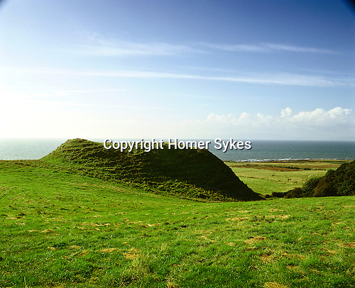 Torr a' Chaisteal Dun. Near Corriecravie, Isle of Arran, North Ayrshire, Scotland. Celtic Britain published by Orion. Natural knoll was first fortified 1,800 years ago. The square top contains a three metre thick circular stone wall of a ruined dun.