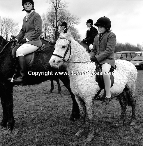 The Duke of Beaufort Hunt...A young rider on an unusual furry horse. The Boxing Day Meet, Worcester Lodge, near Didmarton, Gloucestershire 2002. Hunting makes a huge contribution to the local rural economy. It is estimated that around 800 horses are kept in the Beaufort country for the purpose of hunting. .