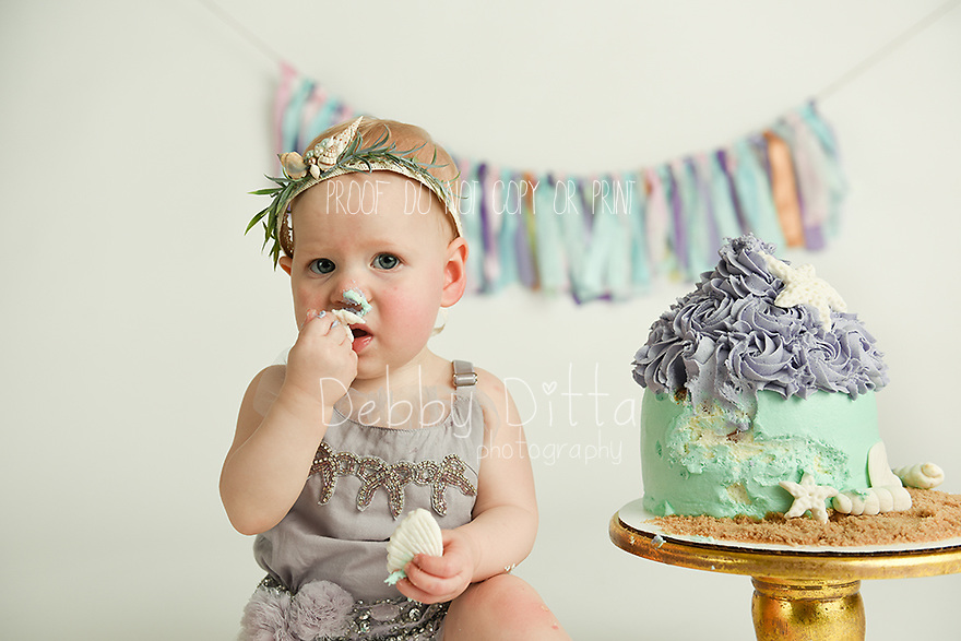 Photography by Debby Ditta of Tomball Texas specializing in newborn baby, children, family, and maternity photography One year old baby cake smash birthday session. Professional custom boutique photography in Tomball Texas. Photographer Debby Ditta