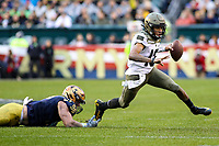 Philadelphia, PA - December 14, 2019:     Army Black Knights quarterback Christian Anderson (13) breaks a tackle during the 120th game between Army vs Navy at Lincoln Financial Field in Philadelphia, PA. (Photo by Elliott Brown/Media Images International)