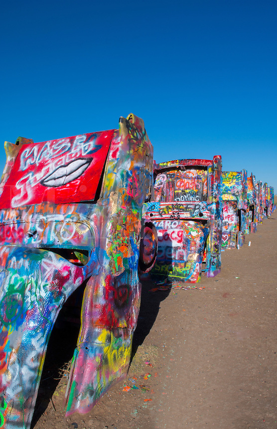 Amarillo Texas famous Cadillac Ranch off of Route 66 graphic look at old Cadillacs buiried in ground on Rt 66