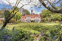 BNPS.co.uk (01202) 558833. <br /> Pic: SandersonYoung/BNPS<br /> <br /> The house and the large garden.<br /> <br /> A quirky 'show home' for a brickwork owner where Lewis Carroll is believed to have stayed while writing some of his Alice in Wonderland books is on the market for just under £1m.<br /> <br /> Red Cottage is a striking Grade II listed property in Whitburn, Tyne and Wear, where Charles Dodgson, otherwise known as Lewis Carroll, regularly visited family.<br /> <br /> The unusual 179-year-old home was built to show off as many design features as possible, and has a walled garden and even an air raid shelter.