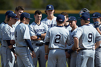 Xavier Musketeers assistant coach Billy O'Conner (2) addresses the team prior to the game against the Penn State Nittany Lions at Coleman Field at the USA Baseball National Training Center on February 25, 2017 in Cary, North Carolina. The Musketeers defeated the Nittany Lions 10-4 in game one of a double header. (Brian Westerholt/Four Seam Images)