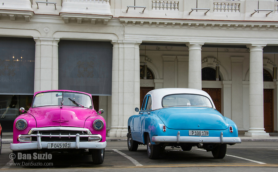 Havana, Cuba - Taxis wait for fares near Parque Central. Classic American cars from the 1950s, imported before the U.S. embargo, are commonly used as taxis in Havana.