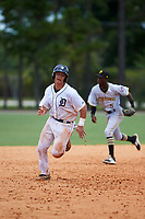GCL Tigers West catcher Sam McMillan (26) running the bases on a Juan Ramirez (not shown) double in the bottom of the eighth inning as second baseman Victor Ngoepe (5) gets in position during a game against the GCL Pirates on July 17, 2017 at TigerTown in Lakeland, Florida.  GCL Tigers West defeated the GCL Pirates 7-4.  (Mike Janes/Four Seam Images)