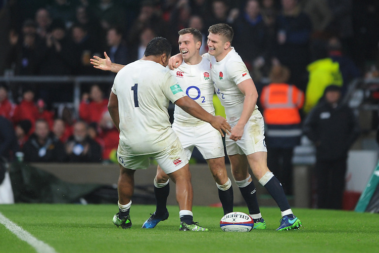George Ford of England celebrates scoring a try as Mako Vunipola and Owen Farrell of England congratulate him during the Old Mutual Wealth Series match between England and South Africa at Twickenham Stadium on Saturday 12th November 2016 (Photo by Rob Munro)