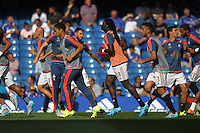 Bafetimbi Gomis of Swansea warms up  during the Barclays Premier League match between  Chelsea and Swansea  played at Stamford Bridge, London