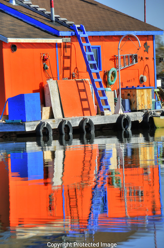 reflection of houseboat in Yellowknife Bay