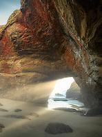 Sea cave at low tide. Devil's Punchbowl State Natural Area. Oregon