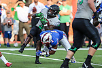 North Texas Mean Green running back Jeffery Wilson (3) and Southern Methodist Mustangs safety Mikial Onu (4) in action during the game between the North Texas Mean Green and the SMU Mustangs at the Gerald J. Ford Stadium in Fort Worth, Texas.