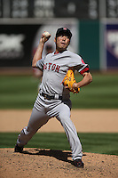 OAKLAND, CA - JUNE 22:  Koji Uehara #19 of the Boston Red Sox pitches against the Oakland Athletics during the game at O.co Coliseum on Sunday, June 22, 2014 in Oakland, California. Photo by Brad Mangin