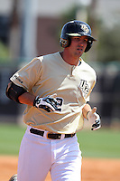 UCF Knights first baseman D.J. Hicks #42 rounds the bases after hitting a home run during a game against the Siena Saints at the UCF Baseball Complex on March 4, 2012 in Orlando, Florida.  Central Florida defeated Siena 15-2.  (Mike Janes/Four Seam Images)