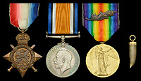 BNPS.co.uk (01202 558833)<br /> Pic: DixNoonanWebb/BNPS<br /> <br /> Pictured: Left to right: The 1914 Star, British War medal, Victory medal and a ceremonial bullet.<br /> <br /> The medals of a hero World War One gunner who was the first to shoot down an enemy aircraft have sold for £5,500.<br /> <br /> Major Francis Small achieved the ground-breaking feat in an Avro biplane on November 22, 1914.