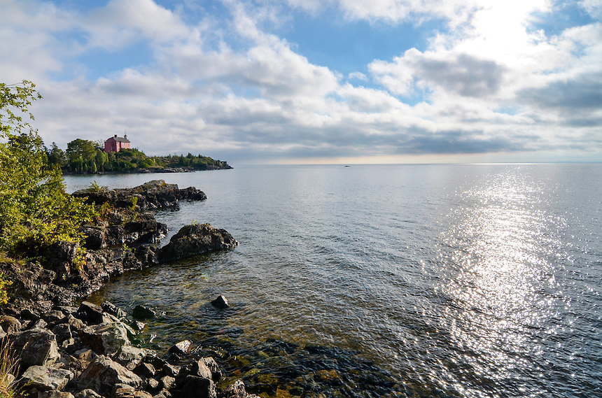 Morning clouds parting over Lake Superior at the Marquette Harbor Lighthouse. Marquette, MI
