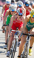 24 JUL 2014 - GLASGOW, GBR - Vicky Holland (ENG) (centre, in red and white) from England drafts Emma Moffatt (AUS) (right) of Australia on the bike during the elite women's 2014 Commonwealth Games triathlon in Strathclyde Country Park, in Glasgow, Scotland (PHOTO COPYRIGHT © 2014 NIGEL FARROW, ALL RIGHTS RESERVED)<br /> *******************************<br /> COMMONWEALTH GAMES <br /> FEDERATION USAGE <br /> RULES APPLY<br /> *******************************