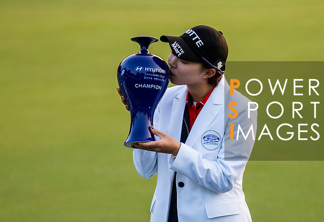 Hyo-joo Kim of Korea celebrates after winning the Hyundai China Ladies Open 2014 at World Cup Course in Mission Hills Shenzhen on December 14 2014, in Shenzhen, China. Photo by Aitor Alcalde / Power Sport Images
