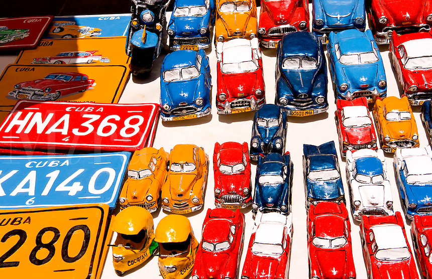 Souvenirs of plates and old cars in street shop of the old colonial city of Trinidad in Cuba