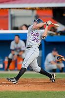 John Semel #25 of the Kingsport Mets follows through on his swing versus the Burlington Royals at Burlington Athletic Park July 3, 2009 in Burlington, North Carolina. (Photo by Brian Westerholt / Four Seam Images)