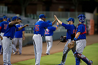 Yonathan Perlaza (15), Alfredo Colorado (75), and Marcus Mastrobuoni (5) congratulate AZL Cubs relief pitcher Jeffrey Passantino (96) as he walks to the dugout between innings during Game Three of the Arizona League Championship Series against the AZL Giants on September 7, 2017 at Scottsdale Stadium in Scottsdale, Arizona. AZL Cubs defeated the AZL Giants 13-3 to win the series two games to one. (Zachary Lucy/Four Seam Images)