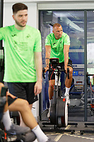 Pictured: Mike van der Hoorn exercises on the gym bike. Thursday 27 June 2019<br /> Re: Swansea City FC players report for training at Fairwood training ground, UK