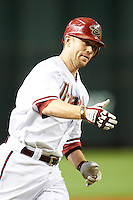 Arizona Diamondbacks second baseman Aaron Hill #2 rounds third after hitting a walk off home run during a National League regular season game against the Colorado Rockies at Chase Field on October 3, 2012 in Phoenix, Arizona. Arizona defeated Colorado 5-3. (Mike Janes/Four Seam Images)