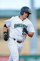 Jupiter Hammerheads first baseman Ryan Rieger (23) runs the bases after hitting a home run during a game against the Tampa Yankees on July 17, 2013 at Roger Dean Stadium in Jupiter, Florida.  Jupiter defeated Tampa 4-3.  (Mike Janes/Four Seam Images)