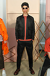 """Model poses in an outfit from the Maiden Noir Spring Summer 2018 """"Return To Stone Garden"""" collection by Nin Truong, for New York Mens Day at Dune Studios on July 10, 2017; duing New York Fashion Week: Mens Spring Summer 2018."""