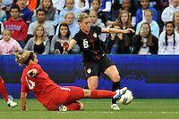 USWNT midfielder Amy Rodriguez(8) evades the tackle of Carmelina Moscato (4) Canada.....USWNT played to a 1-1 tie with Canada at LIVESTRONG Sporting Park, Kansas City, Kansas.
