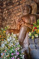 Borobudur, Java, Indonesia.  Mendut Buddhist Temple.  Dhyani Buddha Statue, in the Gesture (Mudra) of Dharmachakra.