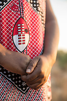Close-up of a woman wearing traditional dress and holding hands, Eswatini
