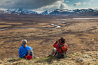 Hikers enjoy view of the Nigu River, Brooks Range, Gates of the Arctic National Park, Alaska.