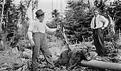 0710-031.  Bear hunters with gun and dead bear.