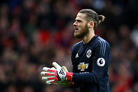 David De Gea of Manchester United rubs his gloves together during the Premier League match between Manchester United and Swansea City at the Old Trafford, Manchester, England, UK. Saturday 31 March 2018