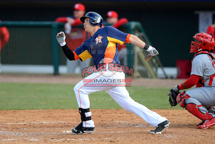 Houston Astros third baseman Brandon Laird #4 hits a home run during a Spring Training game against the St. Louis Cardinals at Osceola County Stadium on March 1, 2013 in Kissimmee, Florida.  The game ended in a tie at 8-8.  (Mike Janes/Four Seam Images)