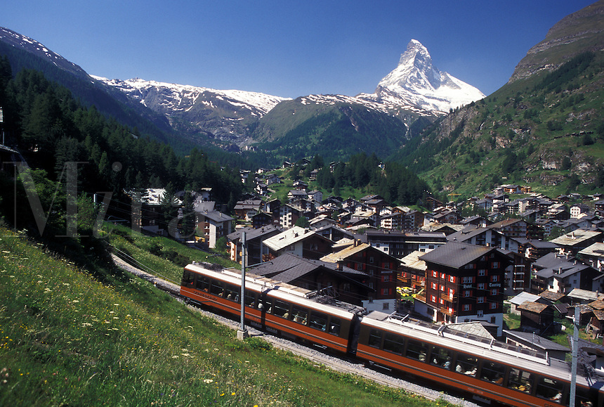 train, Switzerland, Zermatt, Matterhorn, Valais, Alps, Gornergrat Bahn (train) travels through the scenic mountain resort village of Zermatt with a view of the Matterhorn in the Swiss Alps.