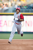 Joe Dunand (10) of the North Carolina State Wolfpack rounds the bases after hitting a home run against the Charlotte 49ers at BB&T Ballpark on March 31, 2015 in Charlotte, North Carolina.  The Wolfpack defeated the 49ers 10-6.  (Brian Westerholt/Four Seam Images)