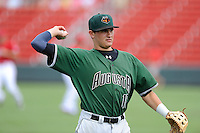 Third baseman Ryder Jones (15) of the Augusta GreenJackets warms up before a game against the Greenville Drive on Sunday, July 13, 2014, at Fluor Field at the West End in Greenville, South Carolina. Jones was a second-round pick of the San Francisco Giants in the 2013 First-Year Player Draft. He is listed as the Giants' No. 15 prospect by Baseball America. Greenville won, 8-5. (Tom Priddy/Four Seam Images)
