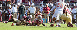 Florida State's running back Cam Ackers, left and quarterback Deondre Francois watch as a high snap rolls away vs Northern Illinois University on September 22, 2018 in Tallahassee, Florida.  The Seminoles defeated the Huskies 37-19.