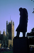 A statue of Winston Churchill watches over the Houses of Parliament in London.
