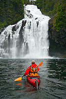 Kayaking near Cascade Falls in Cascade Bay, Prince William Sound, Chugach National Forest, Alaska.