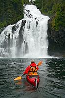 Kayaking near Cascade Falls in Cascade Bay, Prince William Sound, Chugach National Forest, Alaska.