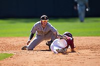 Kennesaw State Owls shortstop Kal Simmons (10) tags out Tyler Asbill (40) of the Winthrop Eagles as he tries to steal second base at the Winthrop Ballpark on March 15, 2015 in Rock Hill, South Carolina.  The Eagles defeated the Owls 11-4.  (Brian Westerholt/Four Seam Images)