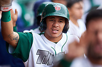 Fort Wayne TinCaps Jawuan Harris (2) is congratulated by teammates after scoring a run during a Midwest League game against the Kane County Cougars at Parkview Field on May 1, 2019 in Fort Wayne, Indiana. Fort Wayne defeated Kane County 10-4. (Zachary Lucy/Four Seam Images)