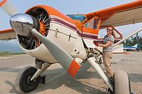 Danielle Tirrell refuels a De-Havilland Beaver airplane at the airport in Coldfoot, Alaska.