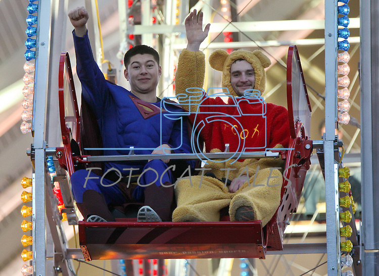 Matt Moerdick, left, and Jason Bell ride in the  Scheels Ferris Wheel Dollar Challenge, a fundraiser for the Northern Nevada Children's Cancer Foundation on Friday, Feb. 1, 2013, at Scheels in Sparks, Nev..Photo by Cathleen Allison