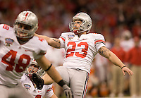 Devin Barclay of Ohio State kicks a PAT against Arkansas during 77th Annual Allstate Sugar Bowl Classic at Louisiana Superdome in New Orleans, Louisiana on January 4th, 2011.  Ohio State defeated Arkansas, 31-26.