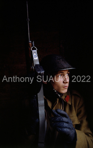 """Bucharest, Romania<br /> December 1989<br /> <br /> Anti-Ceausescu militia surveys a building for pro-Ceausescu snipers.<br /> <br /> The week-long series of violence that overthrew the Communist regime of Nicolae Ceausescu, ended in a trial and execution of Ceausescu and his wife Elena by firing squad. Romania was the only Eastern Bloc country to violently overthrow its Communist regime or to execute its leaders.<br /> <br /> The Romanian populace was dissatisfied with the Communist regime and leader Ceausescu's economic and development policies were blamed for the country's shortages and widespread poverty. The powerful secret police (Securitate) controlled what was essentially a police state. Ceausescu was not pro-Soviet but """"independent"""" on foreign policy. He imitated the hard-line, megalomania, and personality cults of communist leaders like North Korea's Kim Il Sung."""