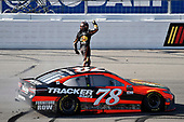 2017 Monster Energy NASCAR Cup Series - Kobalt 400<br /> Las Vegas Motor Speedway - Las Vegas, NV USA<br /> Sunday 12 March 2017<br /> Martin Truex Jr, Bass Pro Shops/TRACKER BOATS Toyota Camry celebrates his win with a burnout<br /> World Copyright: Nigel Kinrade/LAT Images<br /> ref: Digital Image 17LAS1nk07802